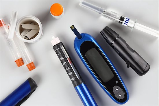 Gestational diabetes mellitus equipment, including an insulin pen and glucose level blood test.