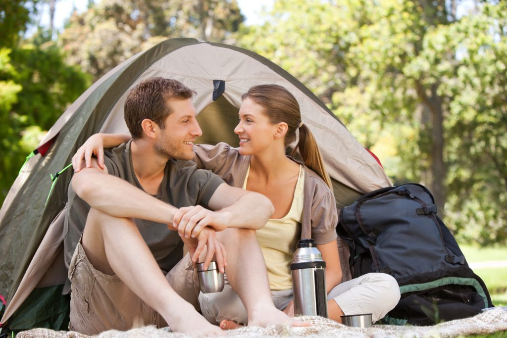 A couple camping in the park to resolve their sleep issues.
