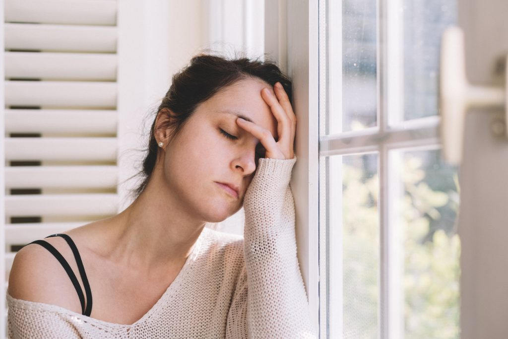 A woman is suffering from a sleep disturbance.