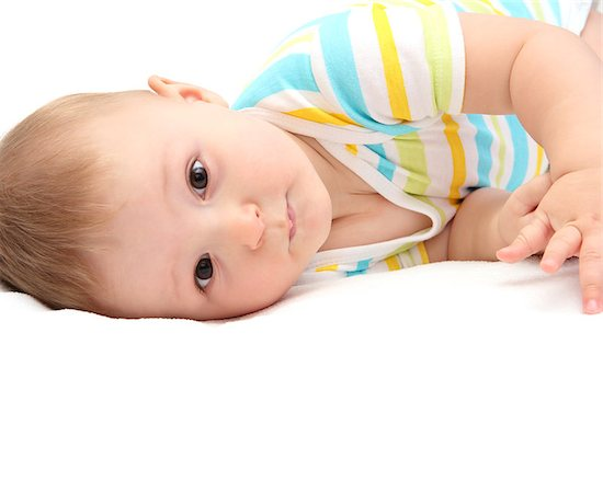 Baby with the potential for hearing loss lying in bed.