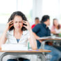 A student struggles with the discomfort associated with allergy symptoms.