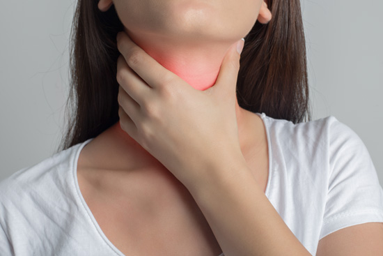 A woman experiences discomfort associated with inflamed tonsils.