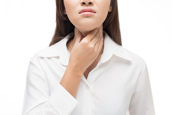 A woman experiences discomfort from thyroid inflammation.