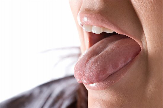 A womans tongue is moistened from healthy salivary glands. if they were to become clogged she would be in a great deal of discomfort.